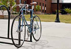 bicycle in rack outside Tebeau Hall