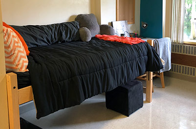 Bed in Bloss Hall room