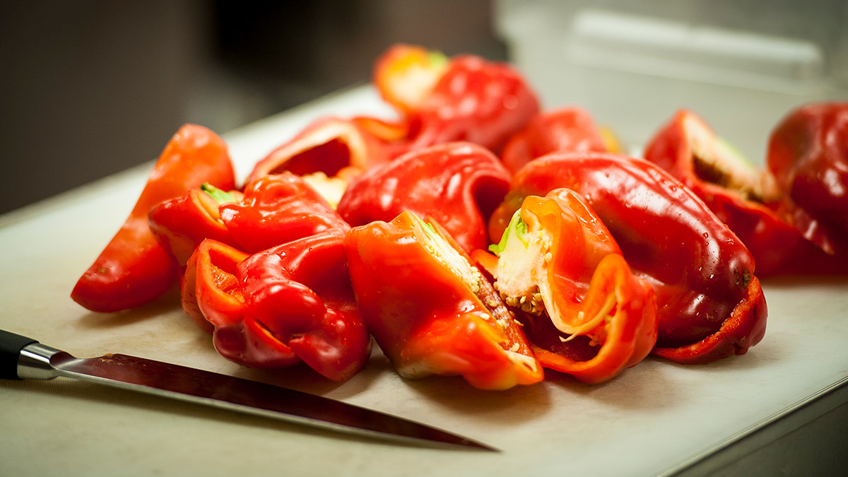 Chopped bell peppers on cutting board
