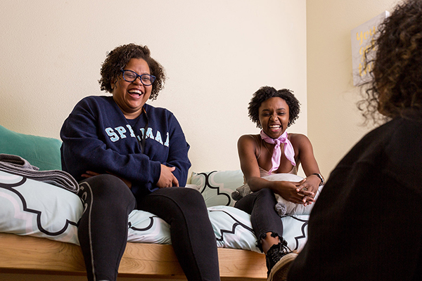 three students laughing in Nia LLC room