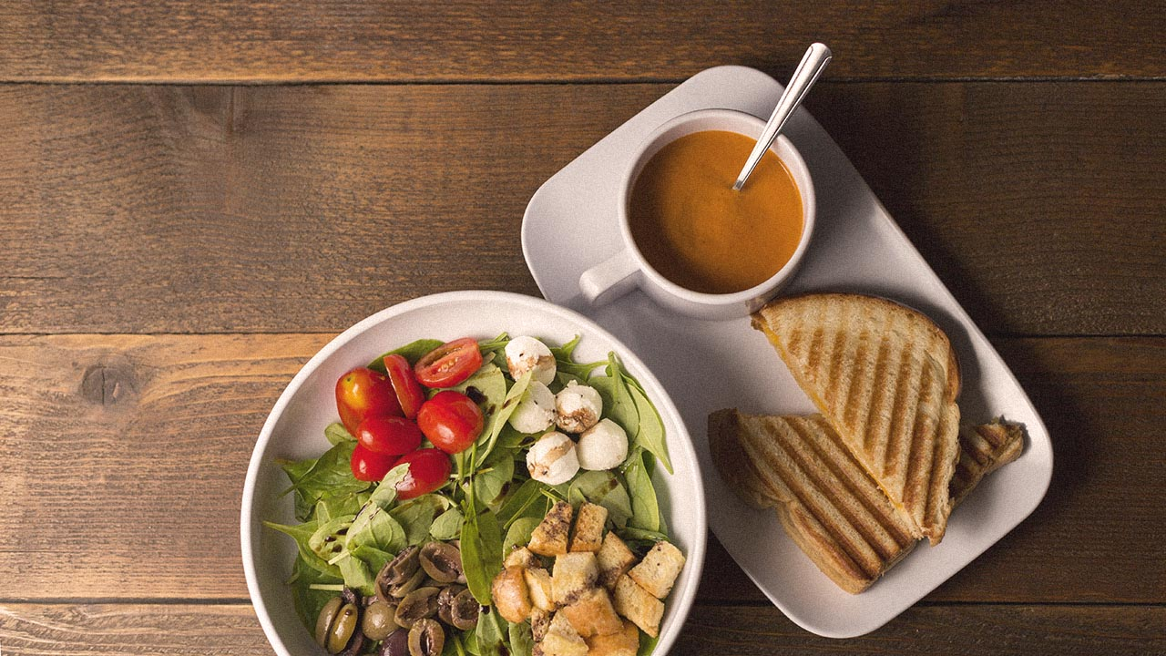 off the quad panini, tomato soup and caprese salad