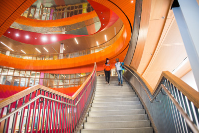 Students walking down staircase in Student Experience Center