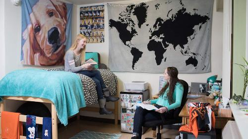 two students in west hall residence hall room