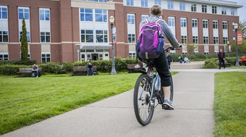 Woman on bike on Oregon State campus